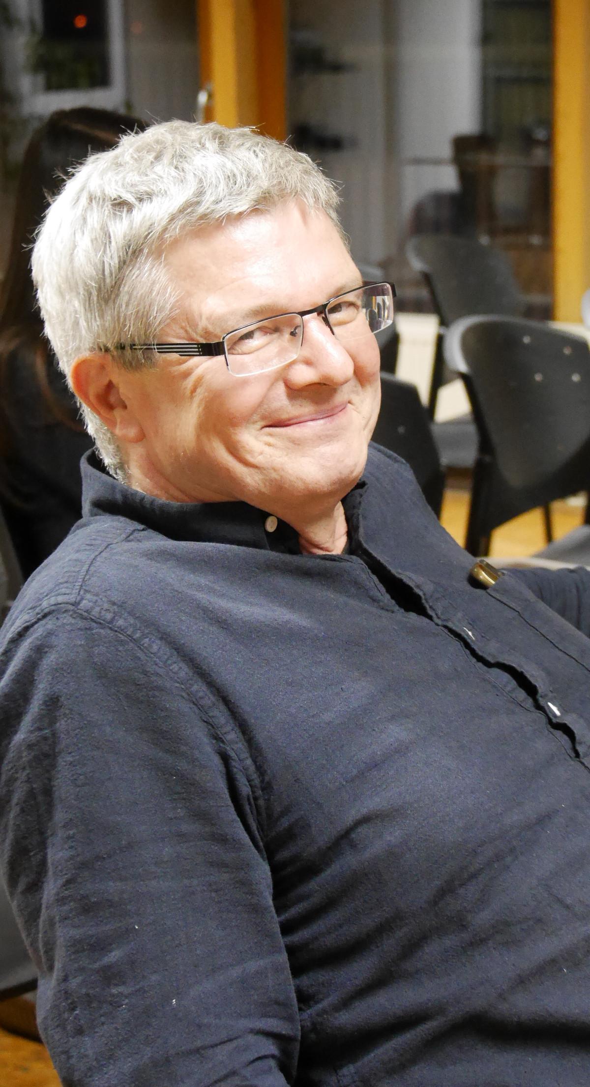 Michael Klein, der Direktor des INM, mit einem frfeundlichen Lächeln